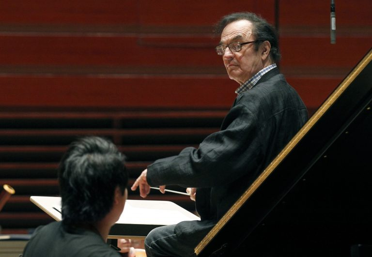 In 2011, world-renowned conductor Charles Dutoit performs with the Philadelphia Orchestra during a rehearsal in Philadelphia. Four women have accused Dutoit of sexual misconduct that allegedly occurred on the sidelines of rehearsals or performances with some of America's great orchestras. The 81-year-old is the artistic director and principal conductor at London's Royal Philharmonic Orchestra and conductor laureate of the Philadelphia Orchestra.   (AP Photo/Alex Brandon, File)
