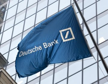 A flag for Deutsche Bank flies outside the German bank's New York offices on Wall Street, Friday, Oct. 7, 2016.