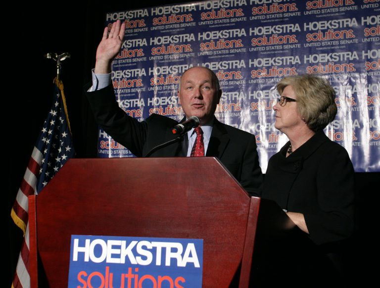 Republican U.S. Senate candidate Pete Hoekstra greets supporters before giving a concession speech as his wife Diane, right, stands by, Tuesday, Nov. 6, 2012, in Grand Rapids, Mich.