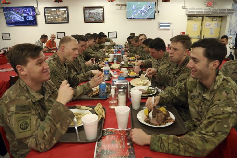 Members of the U.S. military eat Christmas dinner at the Resolute Support Headquarters in Kabul, Afghanistan, Monday, Dec. 25, 2017. (Rahmat Gul/AP Photo)