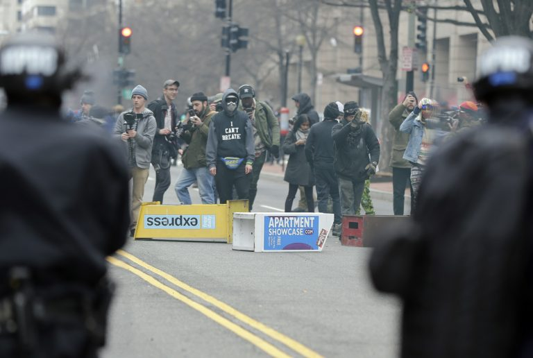 In this Jan. 20, 2017, file photo, protesters face off with police in downtown Washington. A jury has acquitted six people on multiple charges of rioting and destruction of property connected to violent protests during President Donald trump's Jan. 20 inauguration. (Mark Tenally/AP, file)