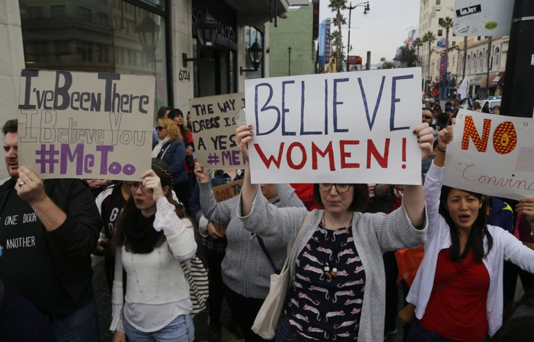 Participants march against sexual assault and harassment at the #MeToo March in the Hollywood section of Los Angeles on Sunday, Nov. 12, 2017.  (Damian Dovarganes/AP Photo)