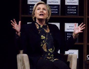Hillary Clinton elaborates on stage at a book tour stop at the Academy of Music in Center City Philadelphia. (Bastiaan Slabbers for WHYY)