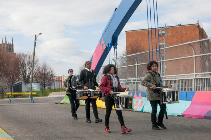 Kensington High School for the Creative and Performing Arts students Ebany Centeno, Marvelis Lima, Laquan Drago and Michael Colon performed on the B Street Bridge in Kensington before the dedication ceremony for a recently completed mural on the bridge. (Brad Larrison for WHYY)