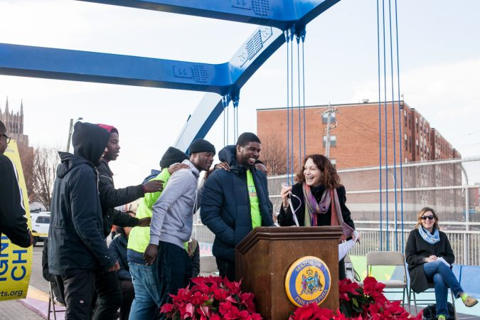 Jane Golden introduced members of the Youth Violence Reduction Parternship Guild who worked on the new mural recently completed on the B Street Bridge in Kensington. (Brad Larrison for WHYY)