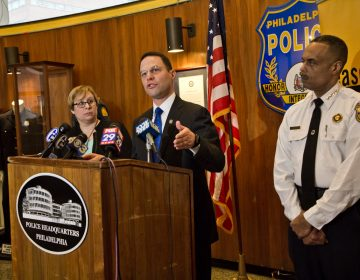 Pennsylvania Attorney General Josh Shapiro (center), Shira Goodman, CeaseFire PA executive director, (left) and Philadelphia Police CommissionerRichard Ross (right) held a press conference at police headquarters Tuesday to express concern over concealed carry reciprocity. (Kimberly Paynter/WHYY)