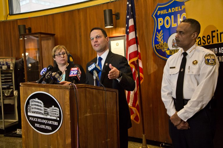 Pennsylvania Attorney General Josh Shapiro (center), Shira Goodman, CeaseFire PA executive director, (left) and Philadelphia Police Commissioner Richard Ross (right) held a press conference at police headquarters Tuesday to express concern over concealed carry reciprocity. (Kimberly Paynter/WHYY)