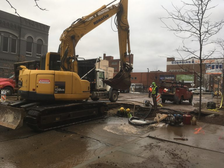 A crew works to repair a 20-inch water main break in Pittsburgh on Monday, Dec. 18. (Liz Reid/WESA)