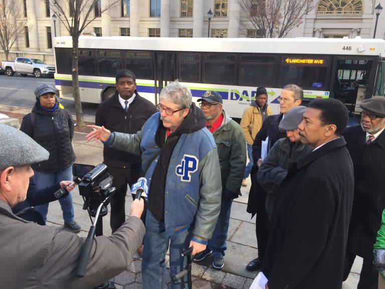 Social activists have received 1,300 petitions against a plan to reroute Wilmington buses. (WHYY/Paul Parmalee)