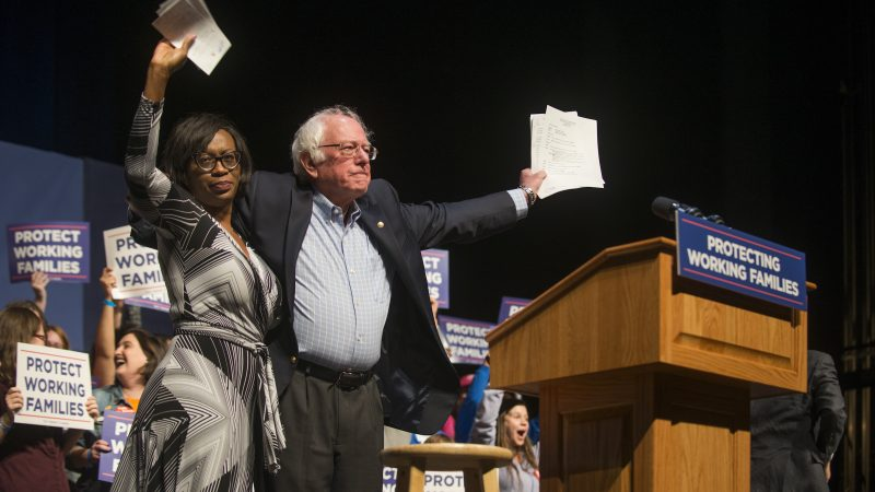 Nina Turner and Bernie Sanders embrace at the Protecting Working Families Rally on December 3 in Reading, Pa.