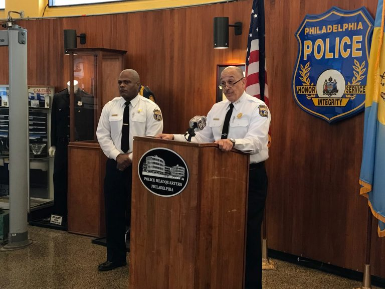 First Deputy Commissioner Myron Patterson, at podium, and Capt. Sekou Kinebrew, a police spokesman, talk to reporters Thursday at Philadelphia police headquarters about a deadly police-involved shooting in Ogontz. (Dana DiFilippo/WHYY)