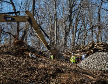 A backhoe clears land for construction of the Mariner East 2 pipeline in Delaware County in early 2017. (Emily Cohen)