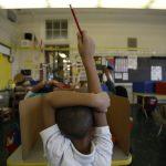 A student raises his hand at Isaac Sheppard School in Philadelphia, Pennsylvania