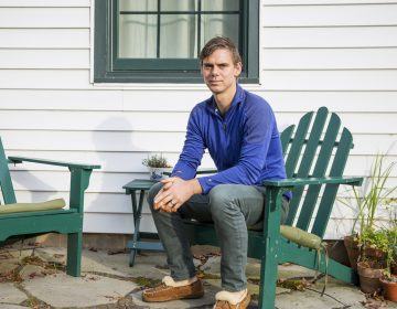 Matt Rooke sits outside of his home in State College, Pennsylvania. A former resident at the Hilltop Mobile Home Park, Rooke said his experience of being displaced gave him insights of the affordable housing problem in the area. (Min Xian/Keystone Crossroads)