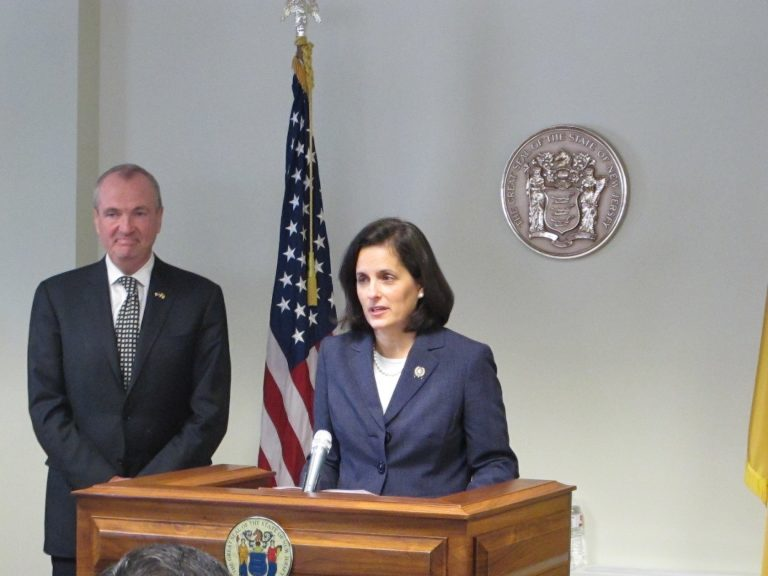 Assemblywoman Liz Muoio, standing with Gov.-elect Phil Murphy,  says she's looking forward to being confirmed as New Jersey state treasurer. (Phil Gregory/WHYY)