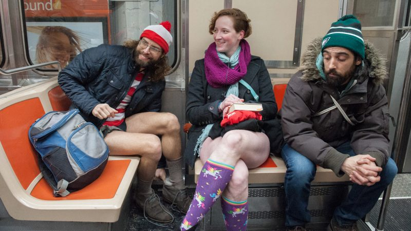 Friends who identified themselves as Waldo, (left) and Koryn (center) participate in the  No Pants Subway Ride on the Broad Street Line, January 8, 2017. (Jonathan Wilson for Newsworks)