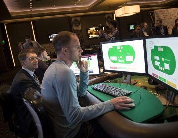 Professional poker player Jason Les sits in front of a computer and tries to beat an A.I. at the game.