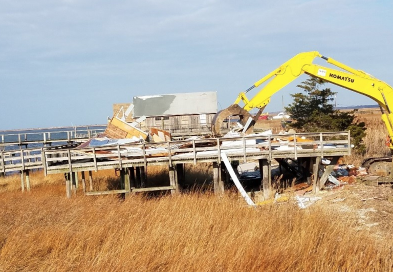 Heavy machinery is used to demolish a house along the Delaware Bay in Lawrence Township. (Image: New Jersey Department of Environmental Protection)