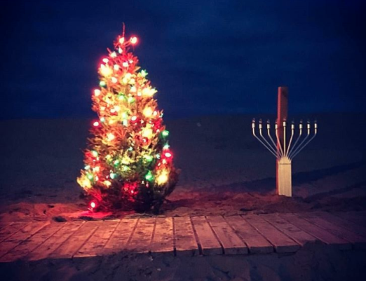 Christmas tree and Menorah on the beach in the village of Loch Arbor in Monmouth County. Photo by  locharbourbeach via #JSHN Instagram)