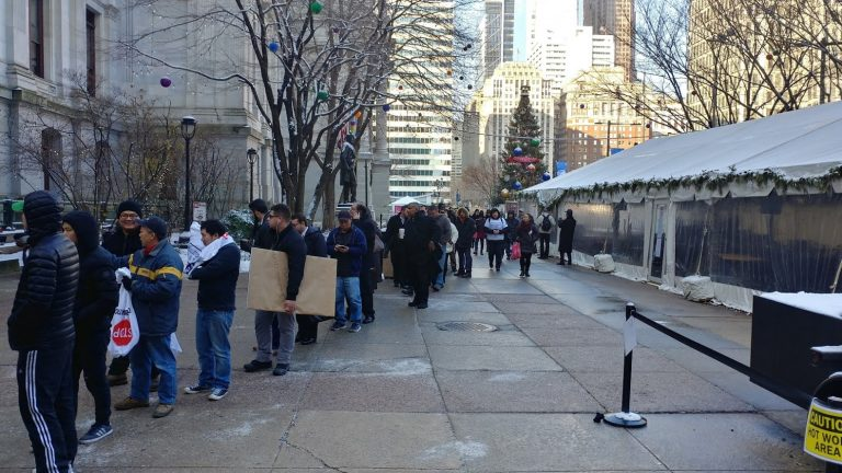 Stop and go owners line up to get into City Hall (Tom MacDonald, WHYY)