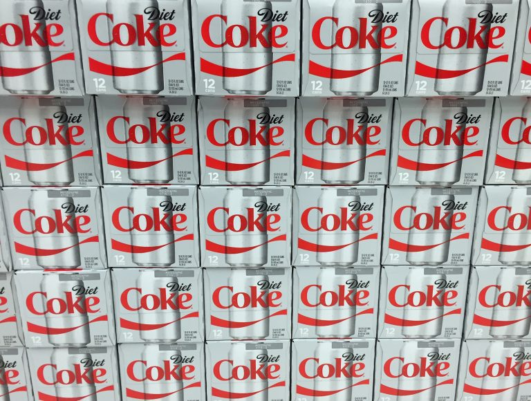 Cases of Diet Coke on display on a grocery store shelf