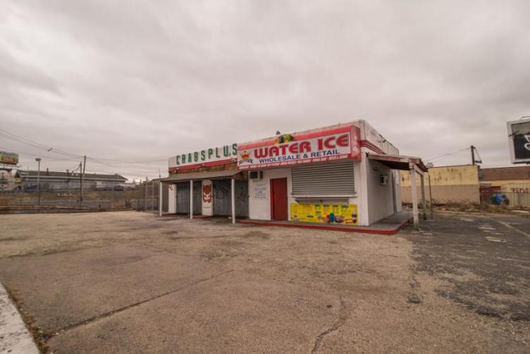 An abandoned wholesale crabs and water ice business sits at Lehigh Avenue and West Oakdale Street.