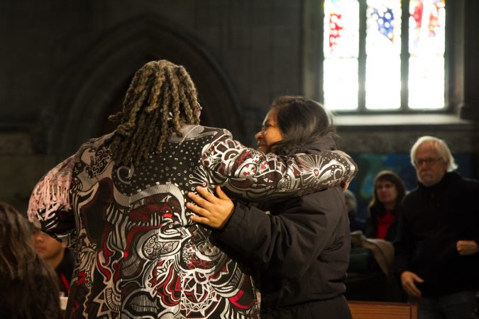 Rev. Renee McKenzie embraces Carmella at the Church of the Advocate in North Philadelphia. (Kimberly Paynter/WHYY)