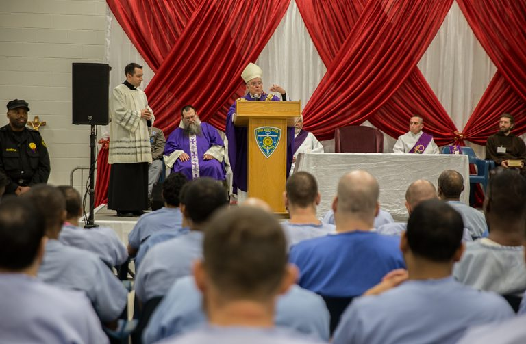 Philadelphia Archbishop Charles Chaput speaks to inmates at the Curran-Fromhold Correctional Center during an annual Christmas Mass at the prison on Dec. 18, 2017. (Lindsay Lazarski/WHYY)