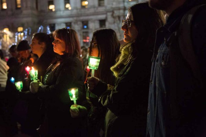 Hundreds of Philadelphians gather at Thomas Paine Plaza to remember the those who died on the streets in 2017 and those who used to be homeless who died. (Emily Cohen for WHYY)