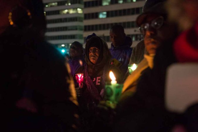 Hundreds of Philadelphians gather at Thomas Paine Plaza to remember the those homeless and formerly homeless who died in 2017 and to call for an end to homelessness on December 21, 2017. (Emily Cohen for WHYY)