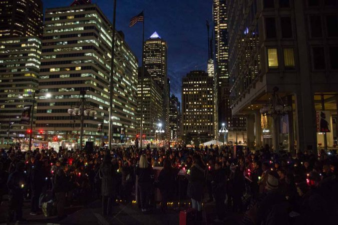 Hundreds of Philadelphians gather at Thomas Paine Plaza on Wednesday night to remember those who are homeless, formerly homeless. (Emily Cohen for WHYY)
