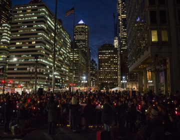 Hundreds of Philadelphians gather at Thomas Paine Plaza to remember the those homeless and formerly homeless Philadelphians who died in 2017 and to call for an end to homelessness on December 21, 2017. (Emily Cohen for WHYY)