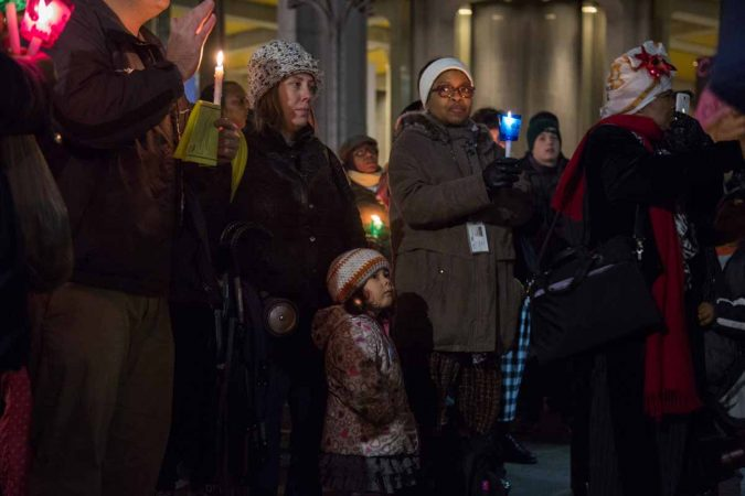 Hundreds of Philadelphians gather at Thomas Paine Plaza to remember the those homeless and formerly homeless people in Philadelphia who died in 2017. They also called for an end to homelessness. (Emily Cohen for WHYY)