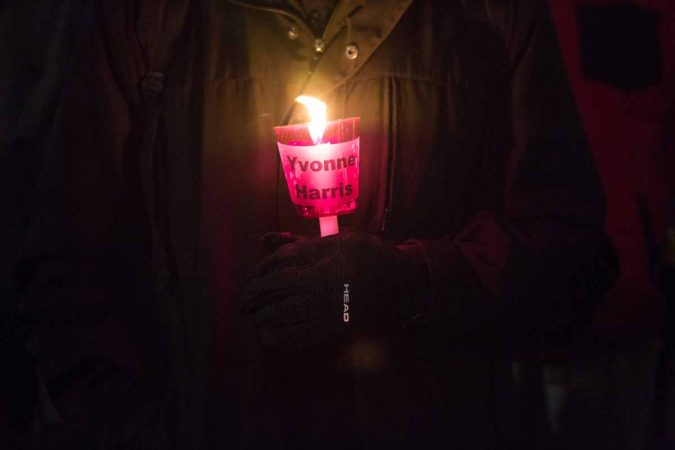 People hold a candle to represent each homeless life lost this year in Philadelphia. (Emily Cohen for WHYY)