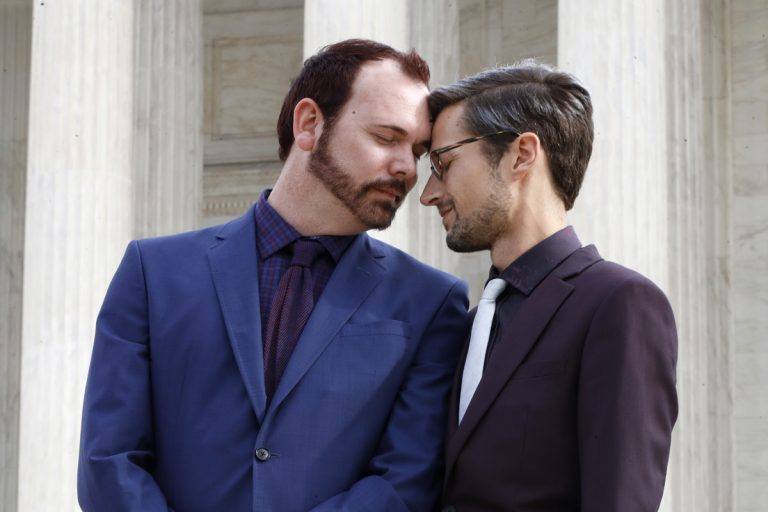 Charlie Craig and David Mullins touch foreheads after leaving the Supreme Court