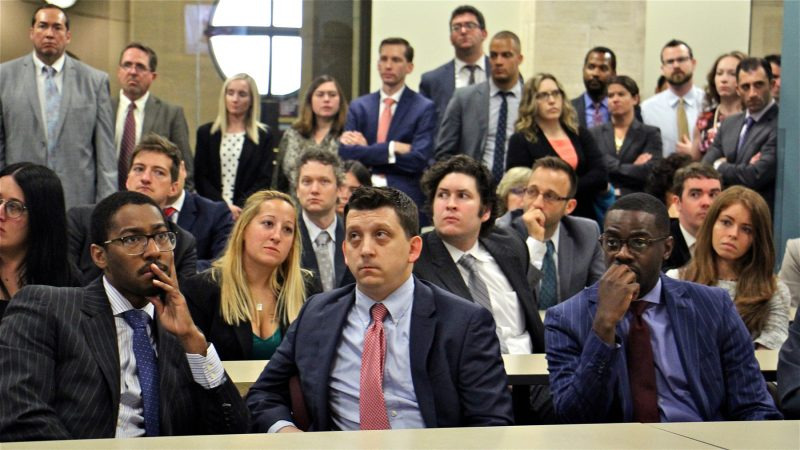 Employees of the Philadelphia District Attorney's Office gather to hear about Seth Williams' resignation and his mid-trial guilty plea to corruption charges. (Emma Lee/WHYY)