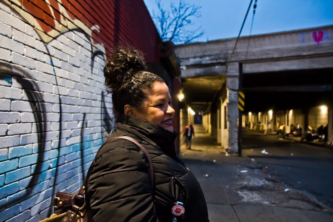 During he spare time, Rosalind Pichardo brings food, clothing, and clean needles to people living beneath an overpass Emerald and Lehigh Streets in Philadelphia.