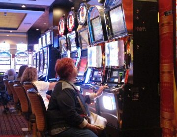 In this June 24, 2016, photo, a gambler plays a slot machine at the Golden Nugget casino in Atlantic City, N.J. On Thursday, Sept. 22, 2016, the men who are proposing to build two new casinos in northern New Jersey near New York City, concluded the statewide ballot question that would authorize the projects will not pass, and ended their financial support for a campaign in its favor. (AP Photo/Wayne Parry)