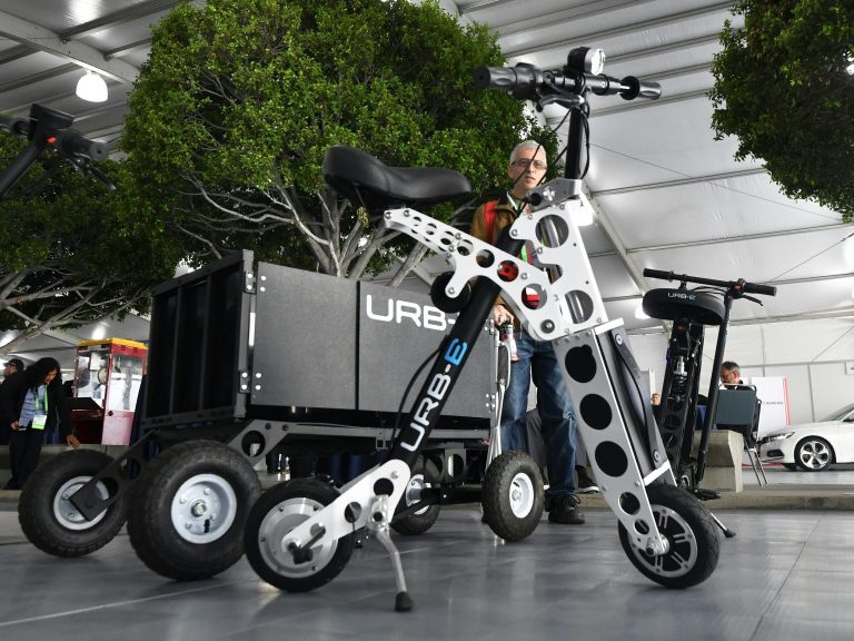 The URB-E electric folding bicycle is displayed Nov. 28 inside the Technology Pavilion at the 2017 LA Auto Show. (Frederic J. Brown/AFP/Getty Images)