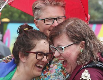 A group of women in Federation Square in Melbourne react on Thursday as it is announced that same-sex marriage will be legal in Australia. (Scott Barbour/Getty Images)