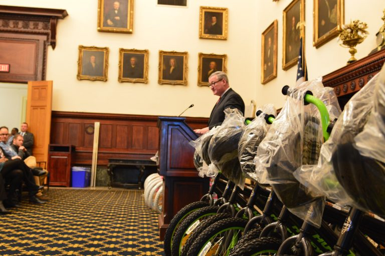 Mayor Jim Kenney speaks before giving away new bikes Wednesday at a City Hall ceremony. (Tom MacDonald/WHYY)