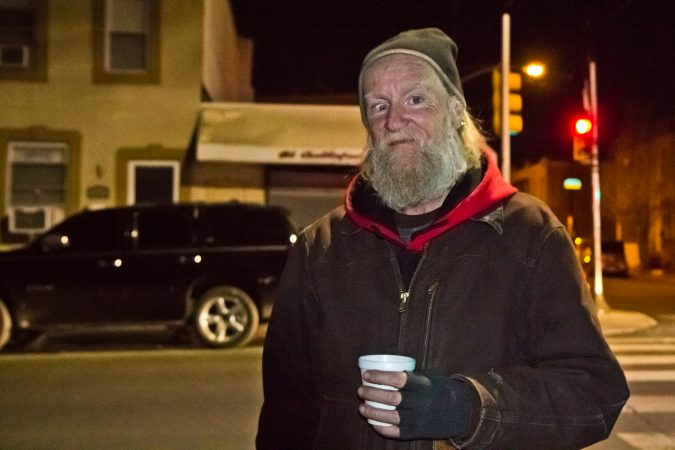 Dennis Payne, a formerly homeless activist, joined different organizations to sing holiday carols at 2nd and Indiana Streets in Kensington. (Kimberly Paynter/WHYY)