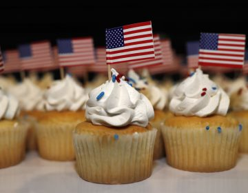 Cupcakes adorned with American flags sit on trays for supporters of Jack Phillips, owner of Masterpiece Cake