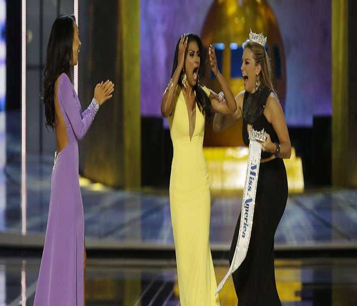 Miss New York Nina Davuluri, center, reacts after being named Miss America 2014 pageant as Miss California Crystal Lee, left, and Miss America 2013 Mallory Hagan celebrate with her, Sunday, Sept. 15, 2013, in Atlantic City, N.J. (Mel Evans/AP Photo)
