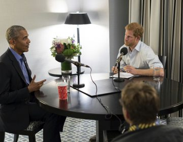 Britain's Prince Harry, right, interviews former U.S. President Barack Obama