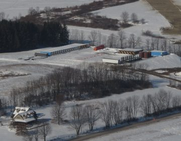 A natural gas well pad in central Pennsylvania, with a home in the foreground. A new study shows infants born to mothers living within a half mile of active fracking sites have a higher risk of low birth weights compared to those living further away. (Scott Detrow/StateImpact Pennsylvania)
