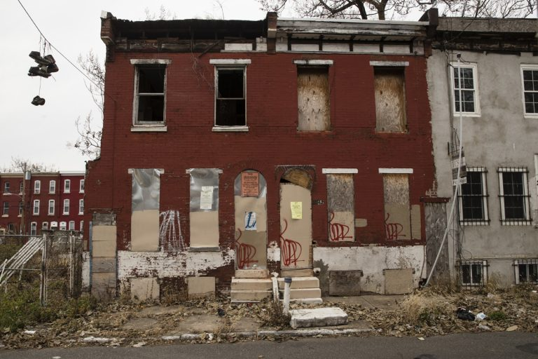 Shown are blighted and abandoned row homes in Philadelphia