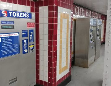 A SEPTA token machine (left) will eventually be taken out of service as the electronic Key fare cards, sold at right, gain popularity. (Tom MacDonald/ WHYY)