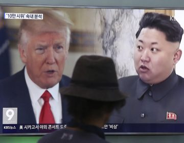 A TV screen shows U.S. President Donald Trump and North Korean leader Kim Jong Un during a news program in Seoul, South Korea.