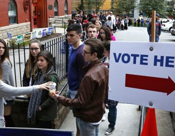 File image of students from Duquesne University waiting in line to cast their votes outside Epiphany Catholic Church in Pittsburgh during the 2016 Election.  A group of Pennsylvania voters are challenging the state's congressional district map as an unconstitutional partisan gerrymander in federal court. They're calling for a new map before the 2018 midterm elections. (AP Photo/Gene J. Puskar)